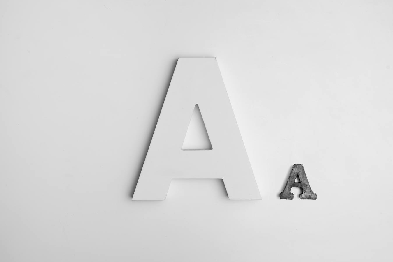 White letter A and small gray letter A