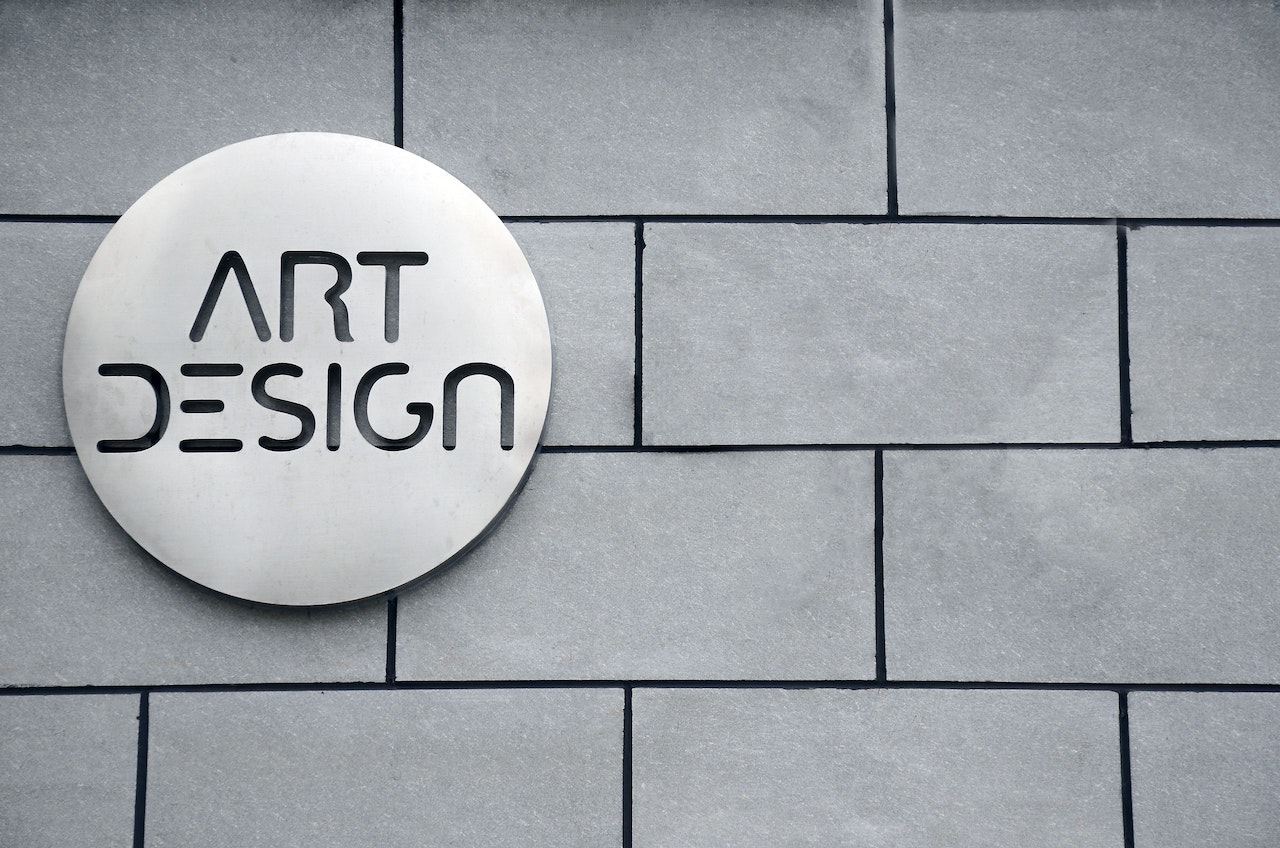 art design logo on brick wall in black and white