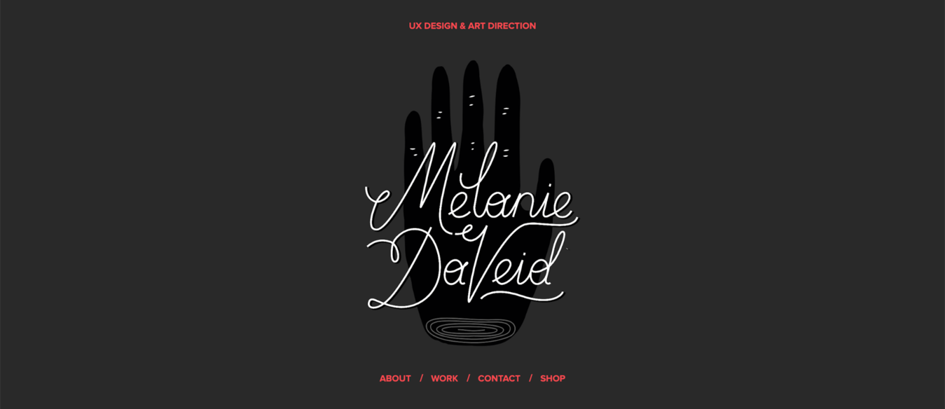 Gray background with black drawing of a hand and a written Melanie Daveid name across it