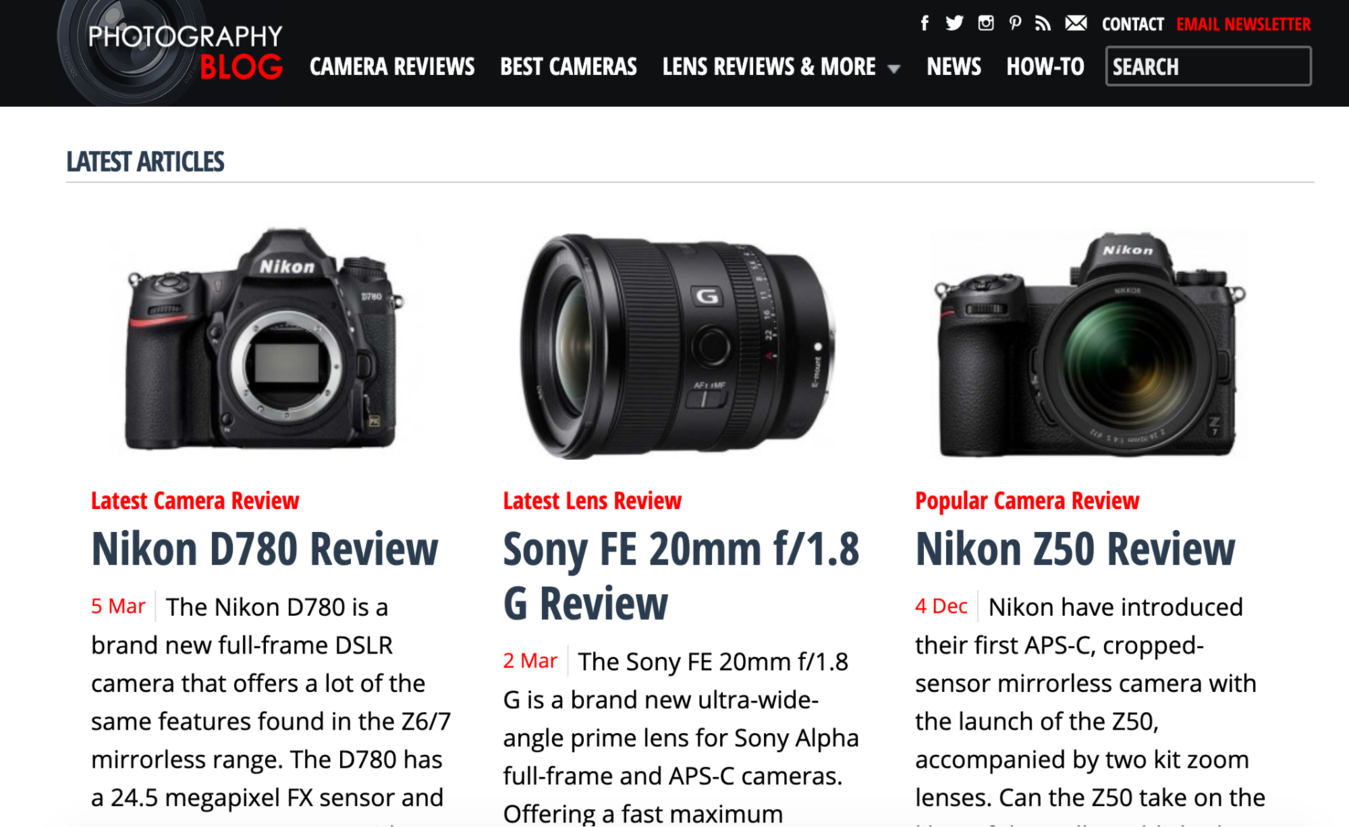 Photography blog showing a camera, lens, and reviews