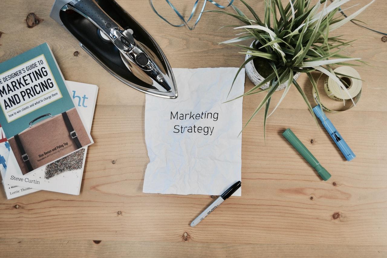 marketing strategy written on a piece of paper on a desk