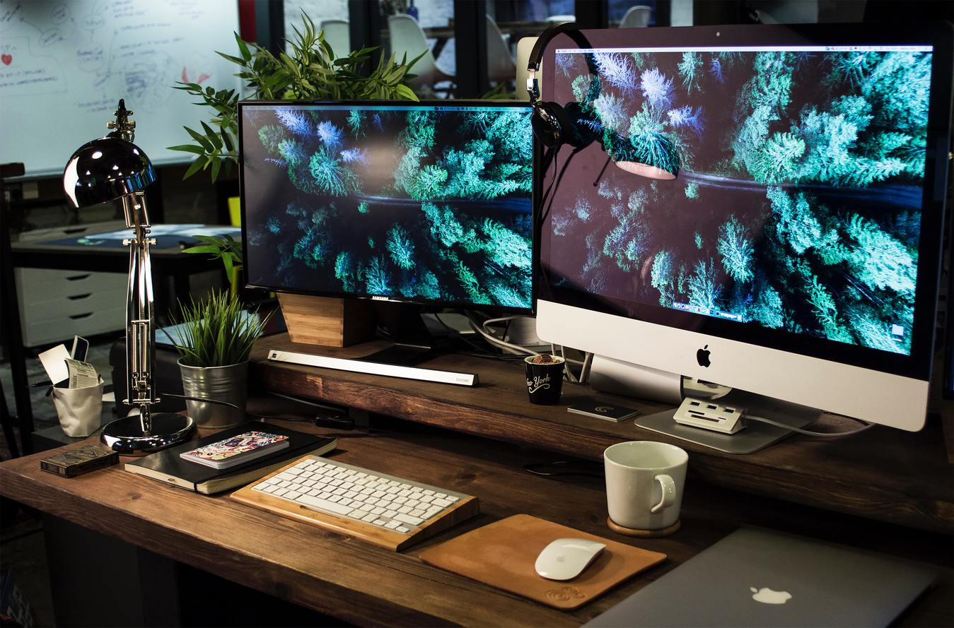 monitor and apple desktop on wooden desk