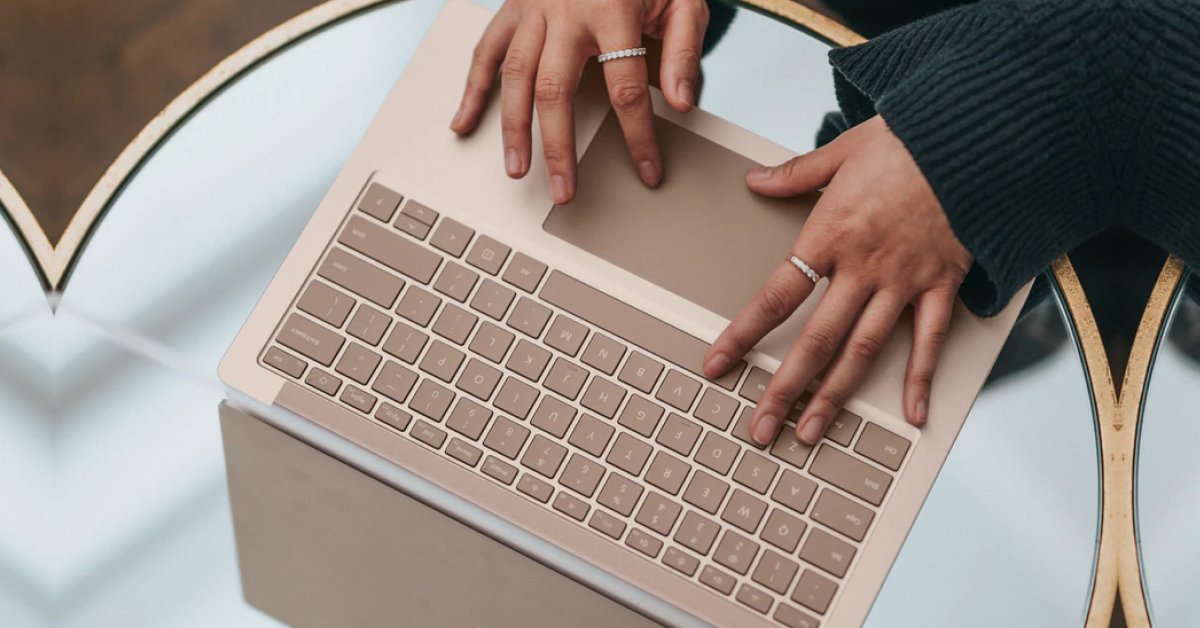 Closeup of a Person Using a Laptop