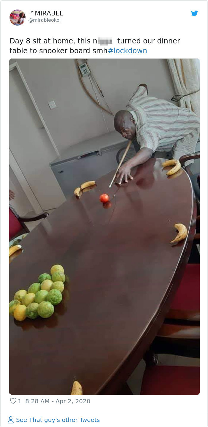 Man playing pool with fruit on kitchen table