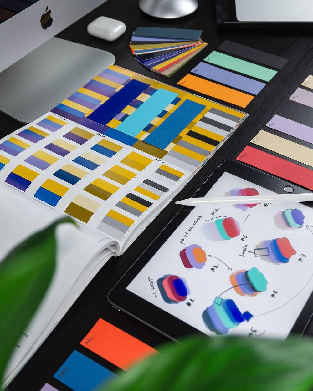 desk covered in card color palettes