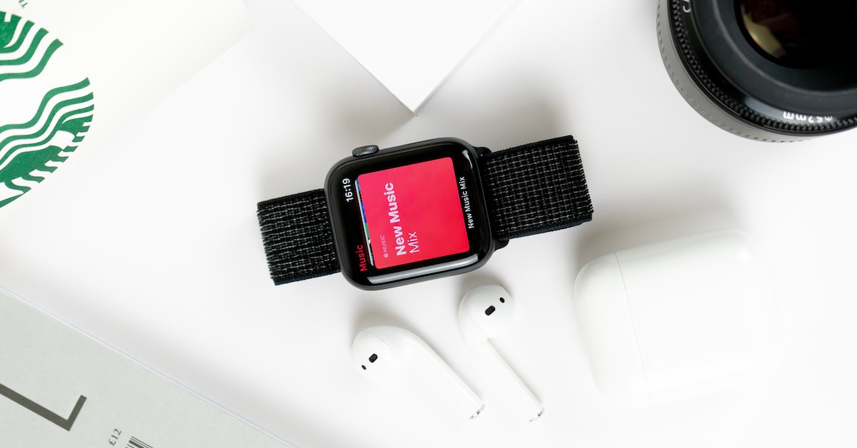 Smartwatch and ear buds on desk