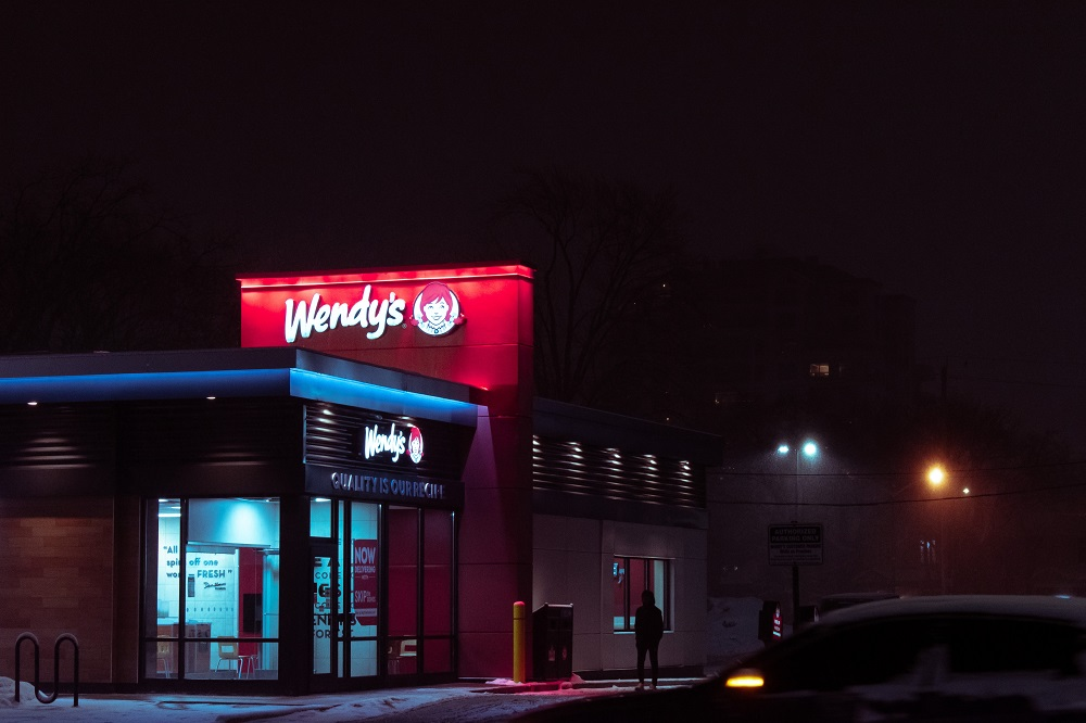 outside shot of wendy's store at night