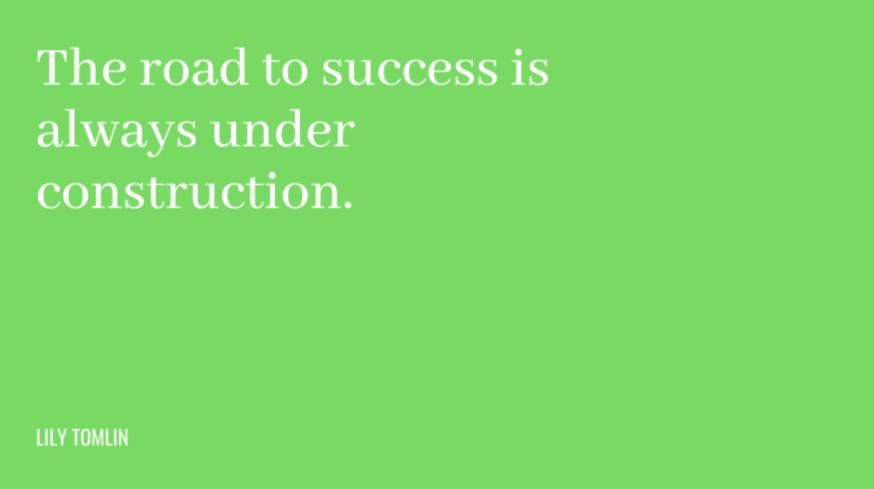 frases motivacionais de trabalho de Lily Tomlin