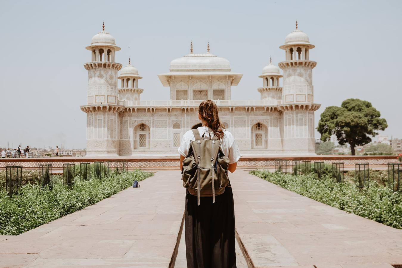 Girl Facing Taj Mahal Wearing Backpack