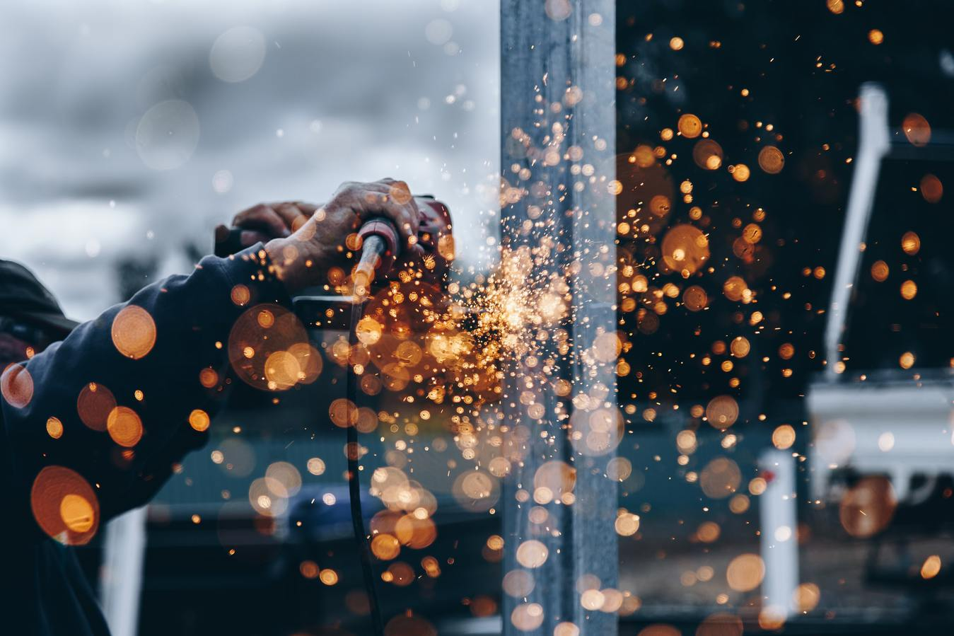 Manufacturing Process Man Welding Sparks Flying