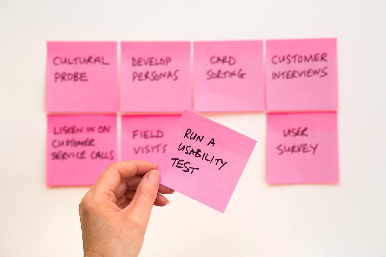 Optimization List on Pink Postit Notes