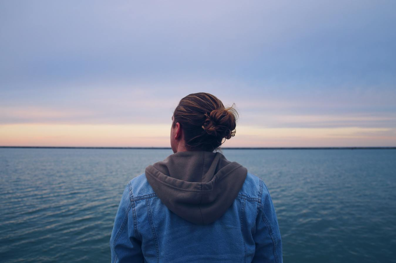 A person looking into the blue horizon