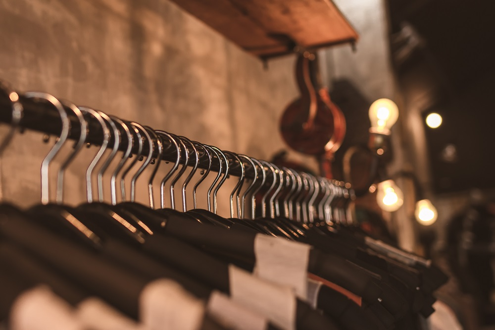 rail of clothes on black hangers