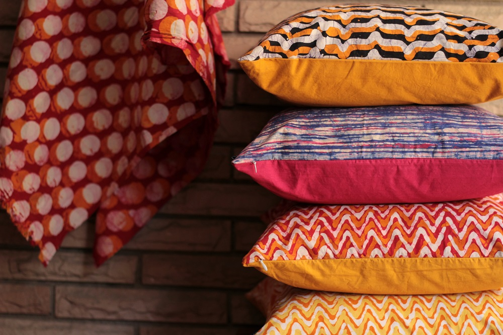 stack of vibrant printed cushions