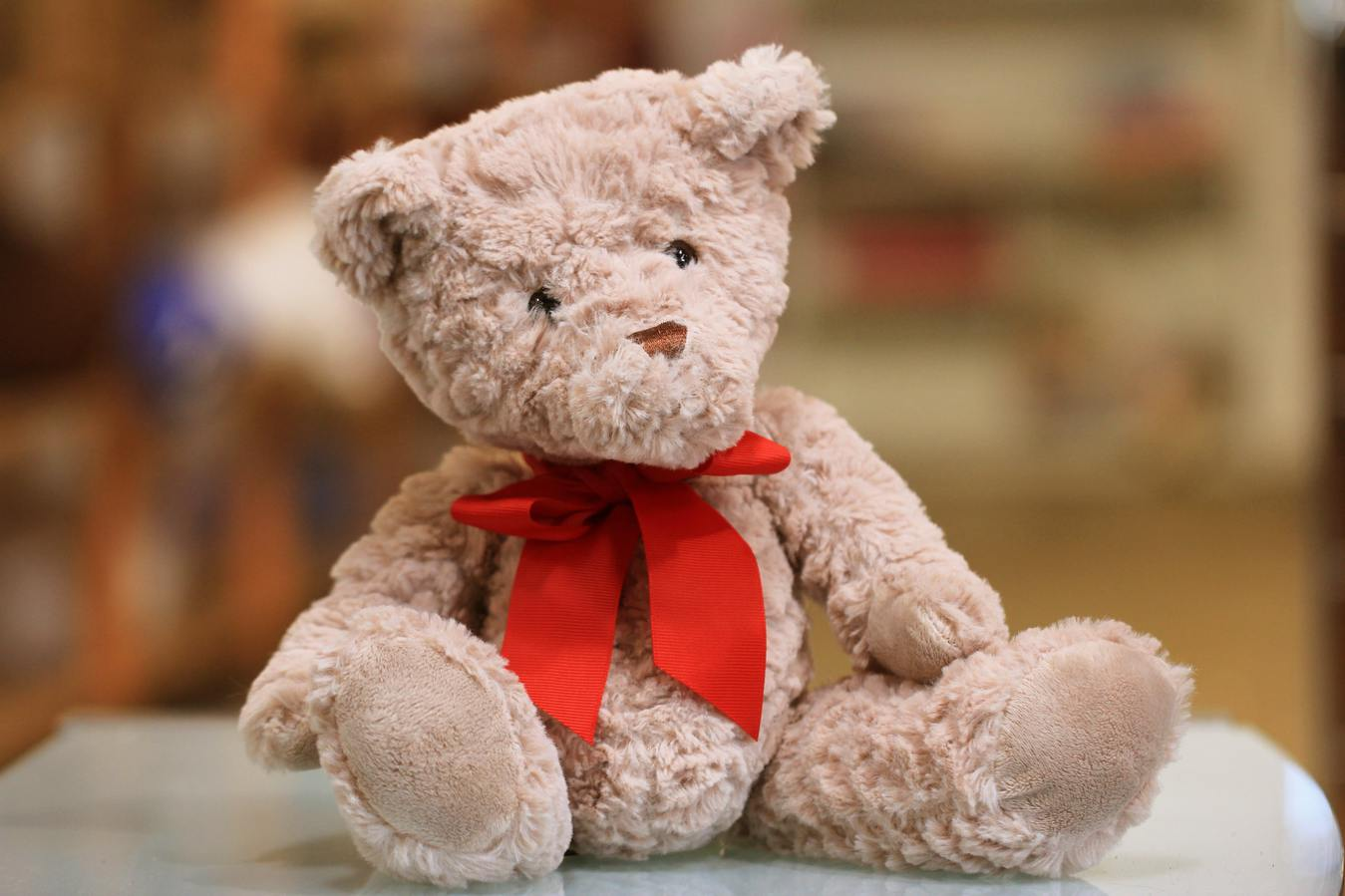 Teddy bear with a red bow sitting