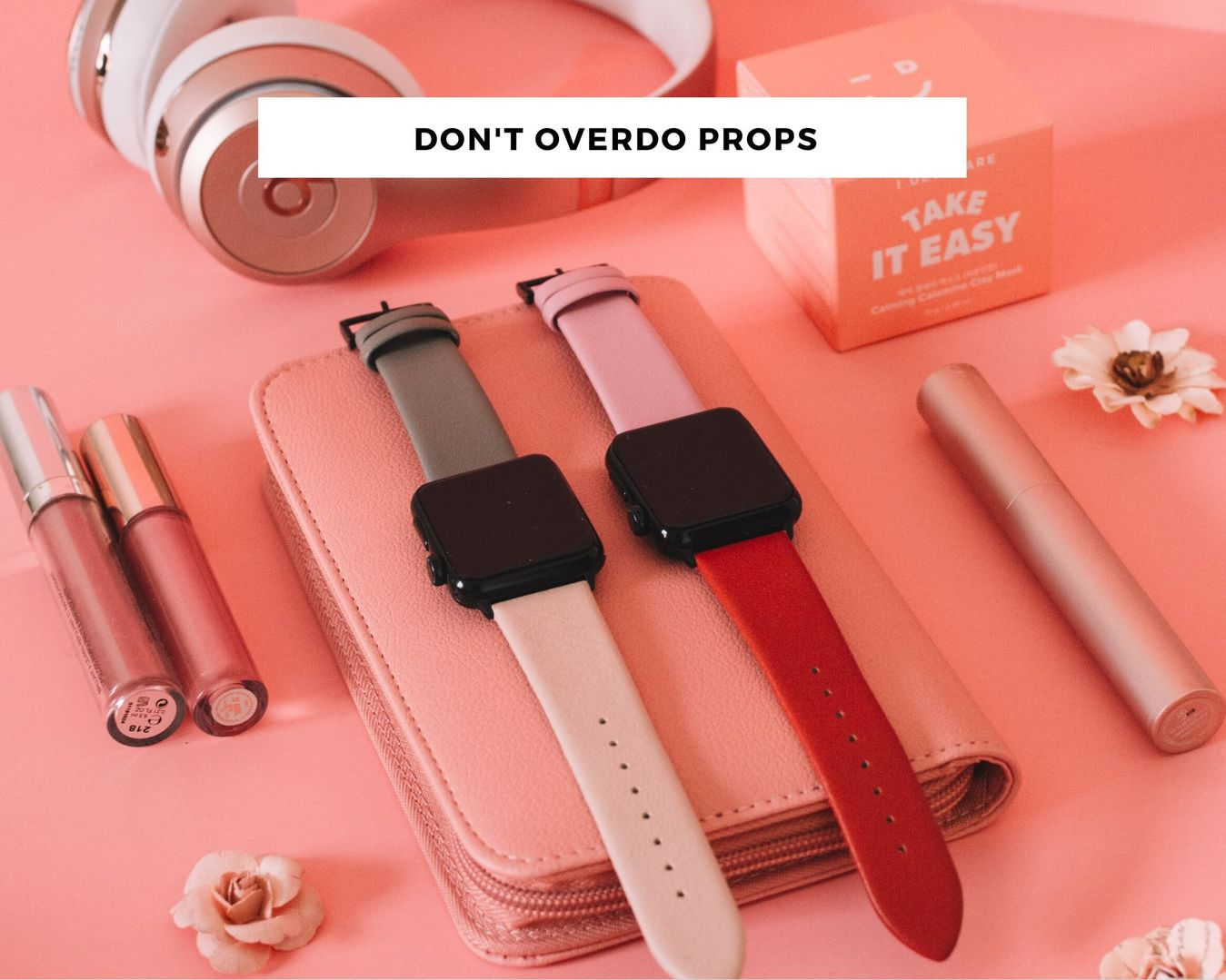 Too many props in a photo example with makeup and electronics