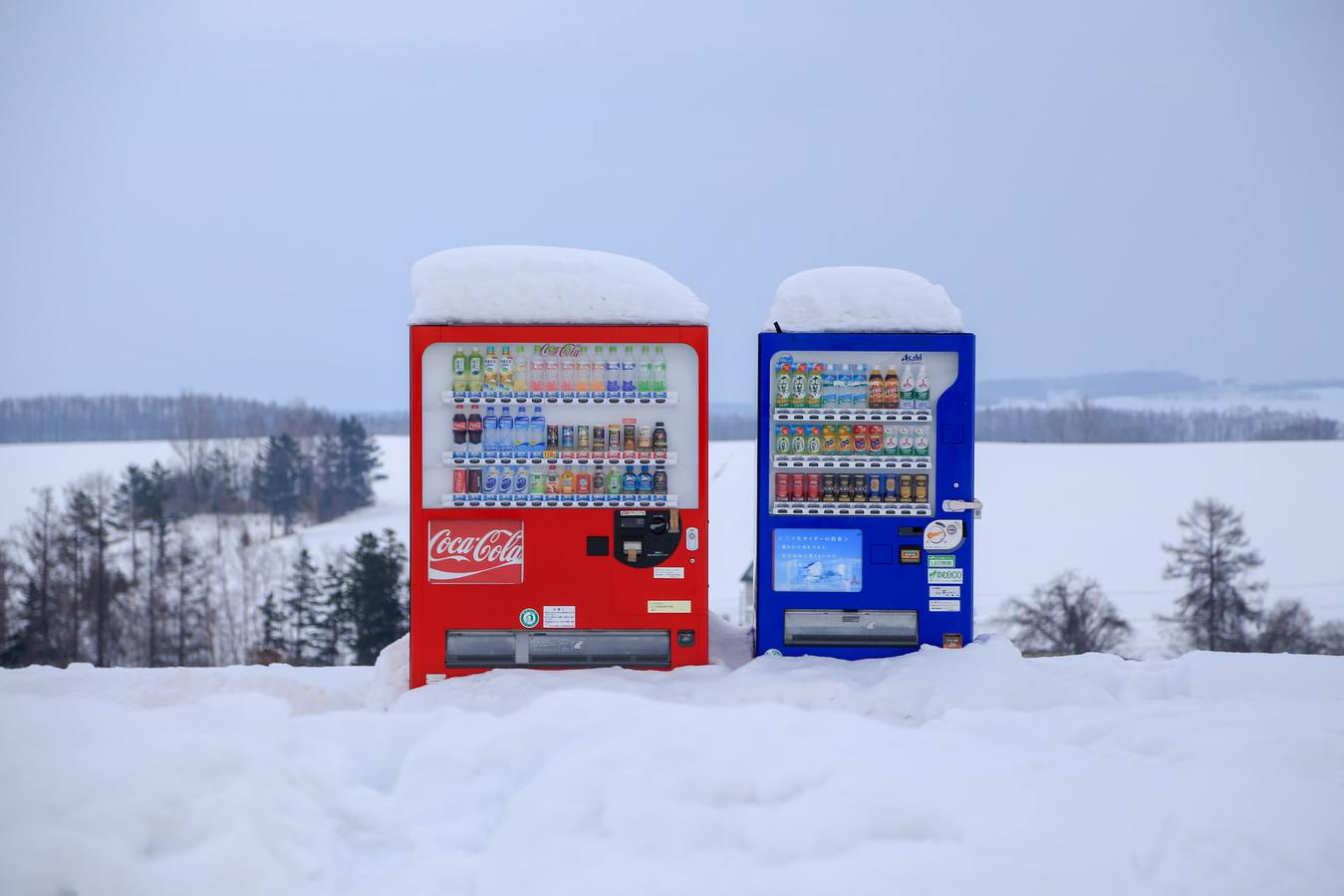 Vending machines with Drinks in Field with Snow