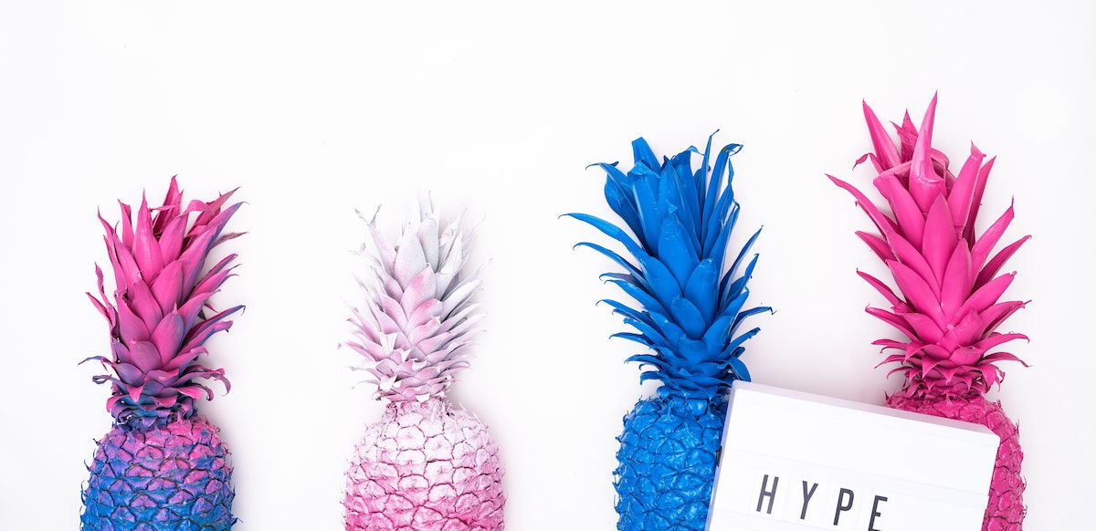 Colorful pineapples against a white background