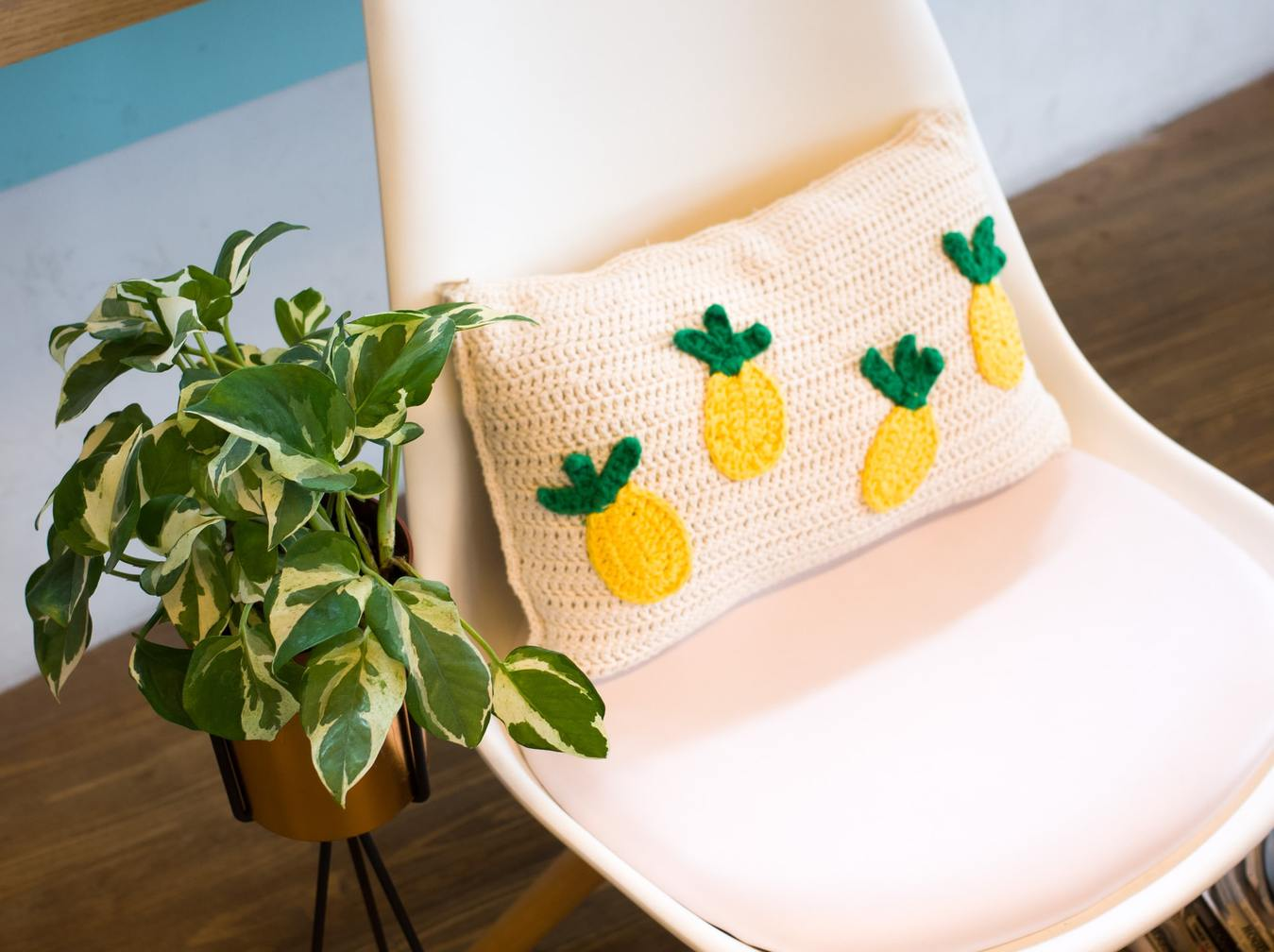 Crocheted Pillow with Pineapples on a Chair