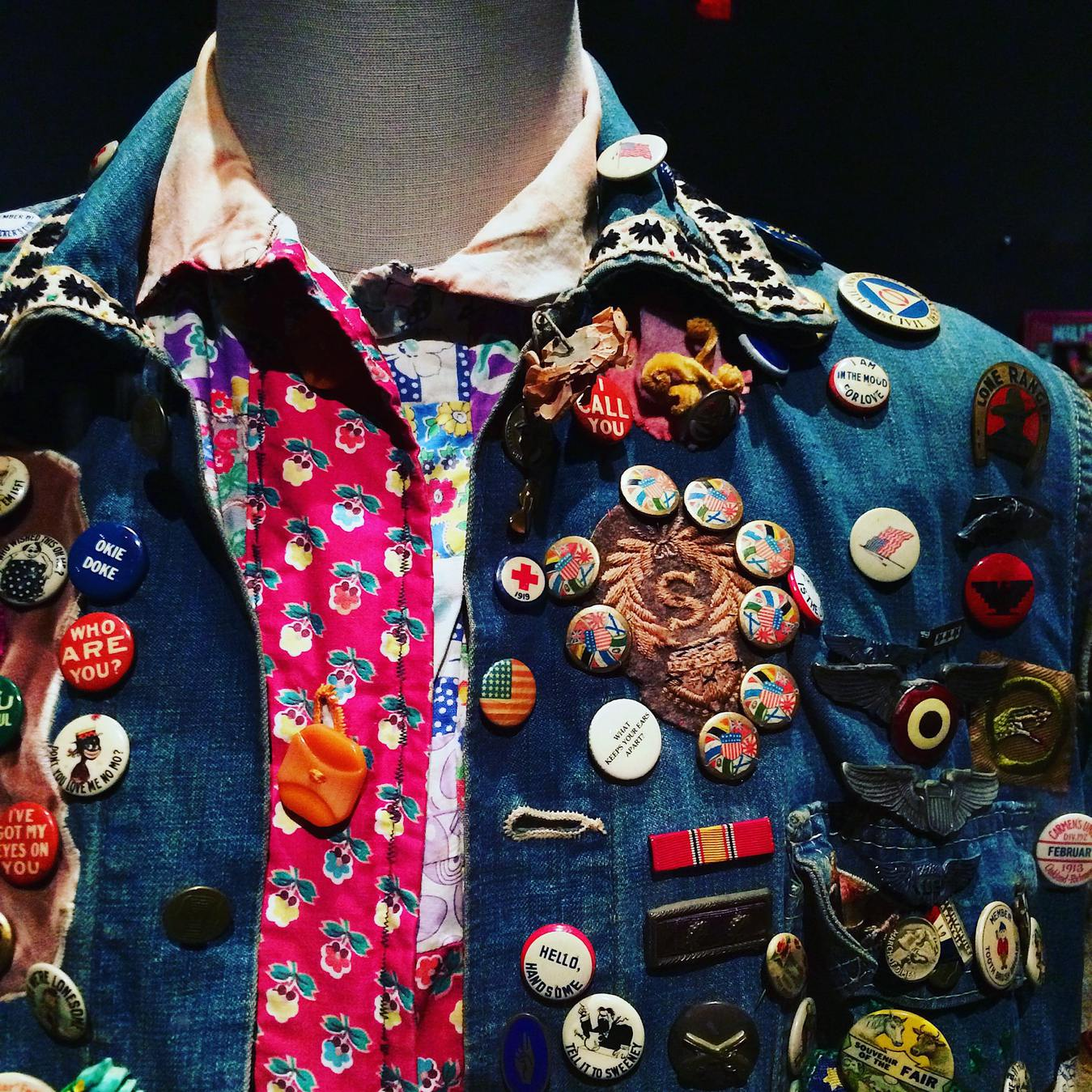 Man with many pins in jacket