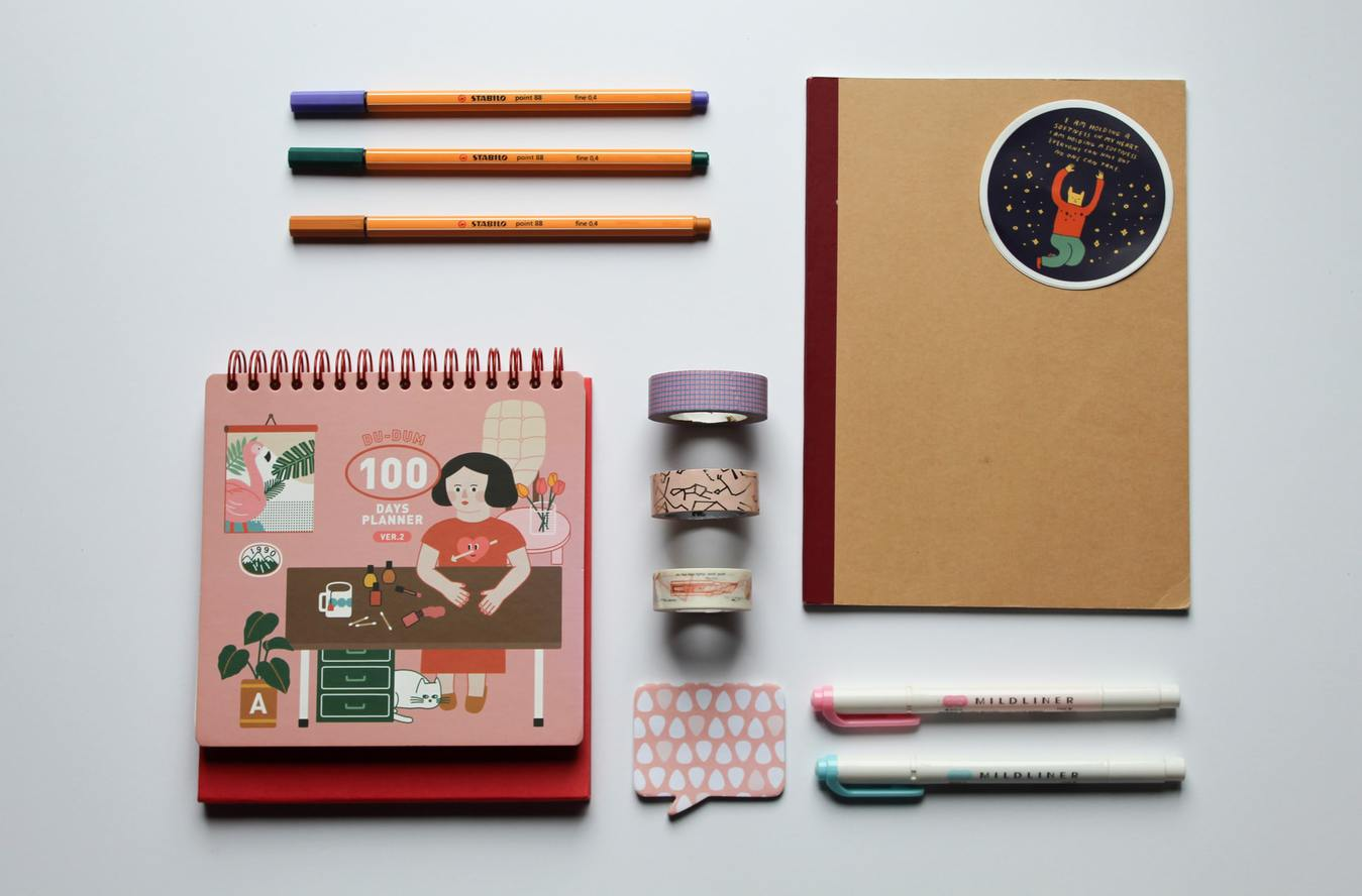 Stationery Top View Arranged on Desk, Notebook and Pens