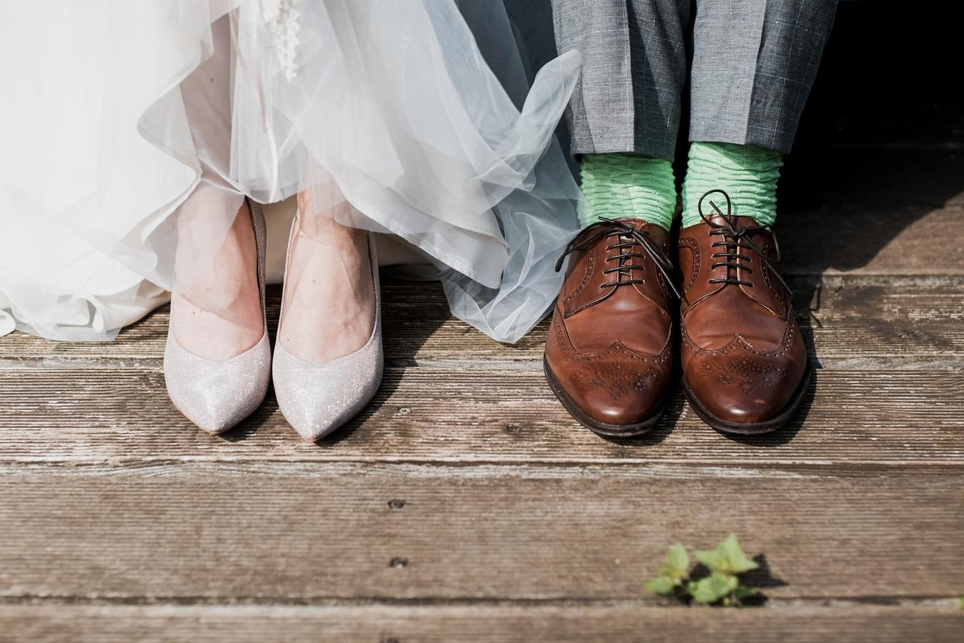 Bride and groom's shoes against a wooden background