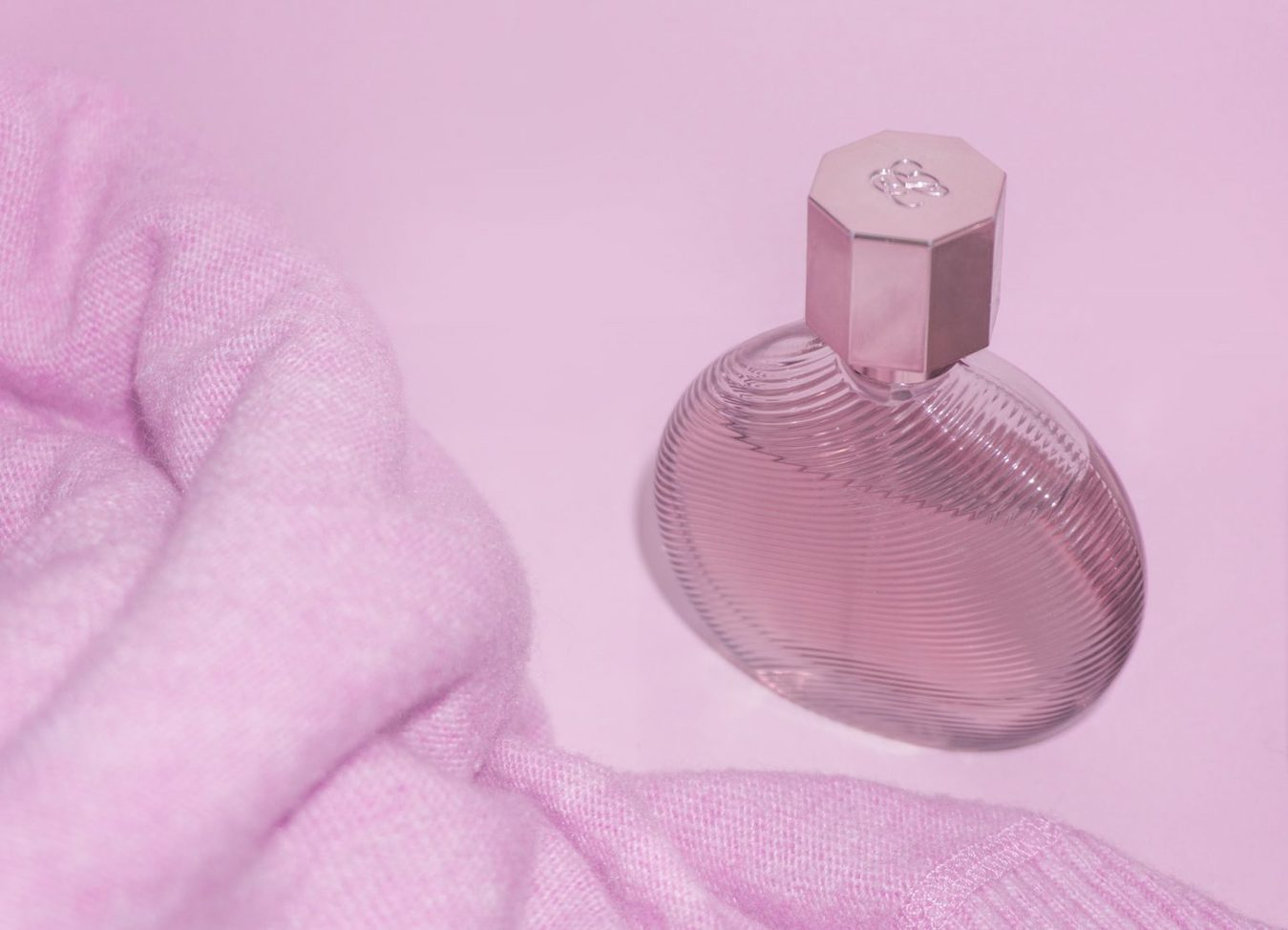 Pink perfume sweater product photography