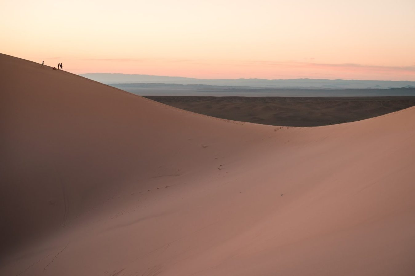 Smooth sand dunes at dusk