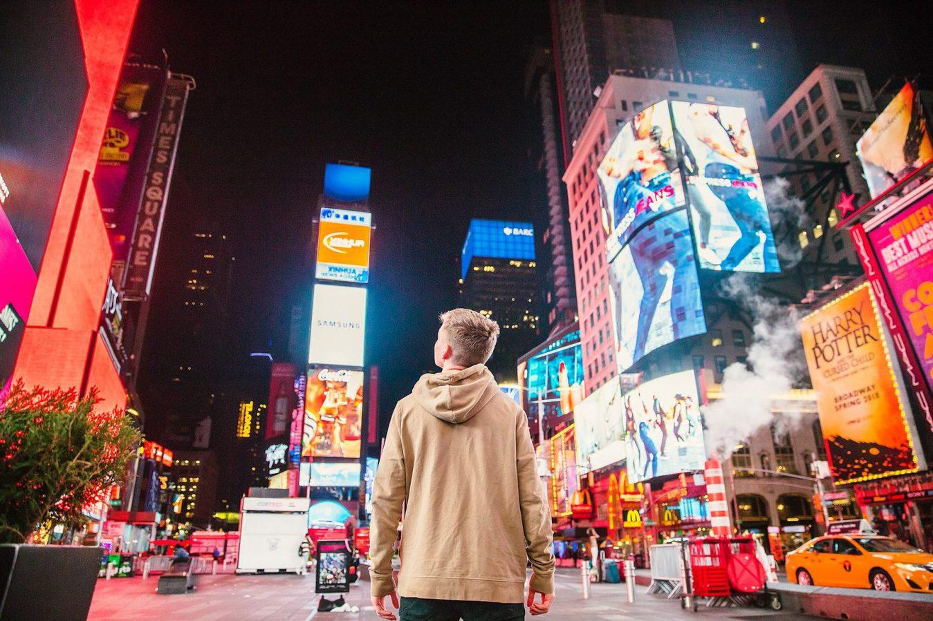 Man standing - billboards at night