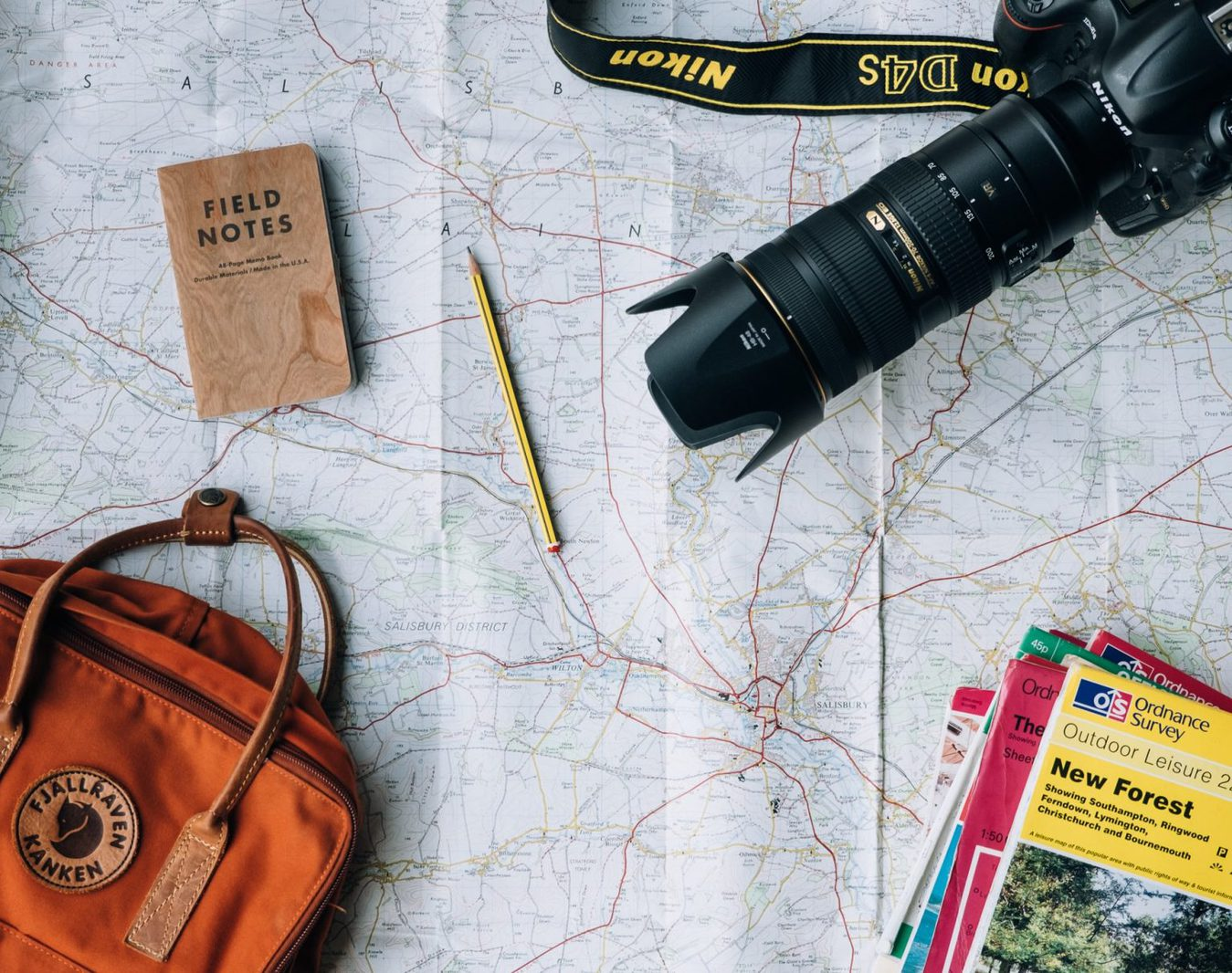 A map with a camera and notebooks on it