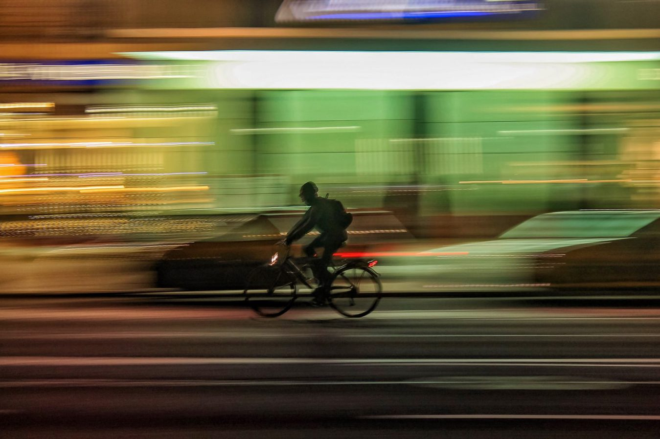Person riding bicycle background blurry