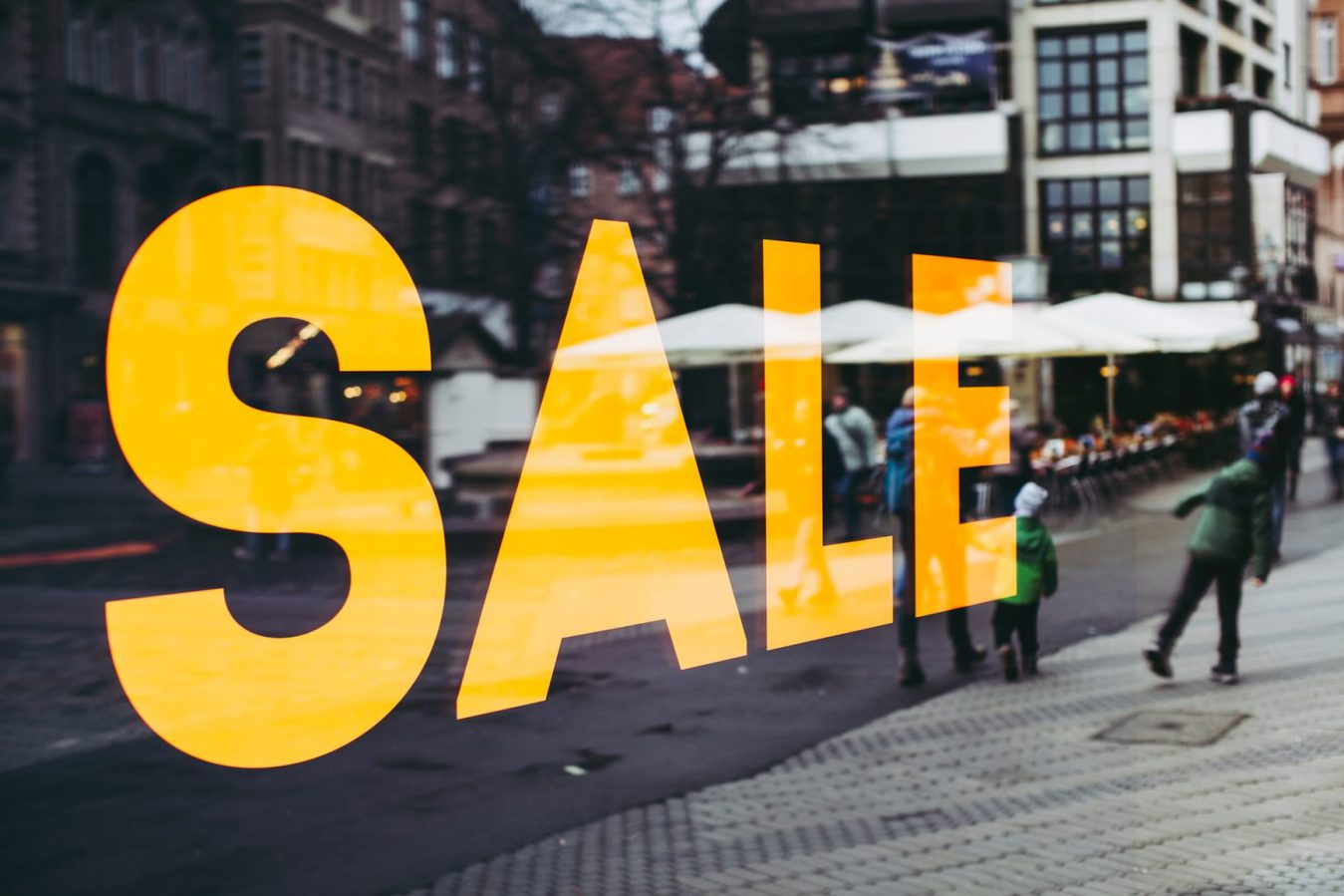 Yellow sale sign in shop window