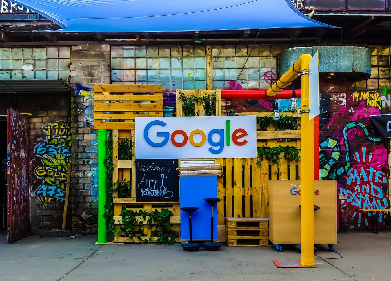 Google sign on a colorful street