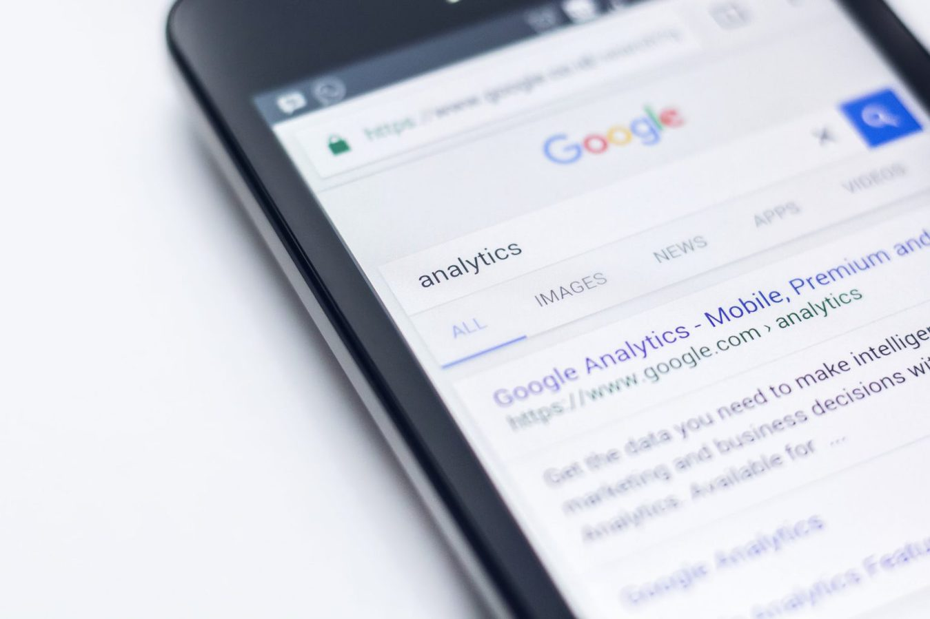 A mobile phone showing search results for a search on analytics
