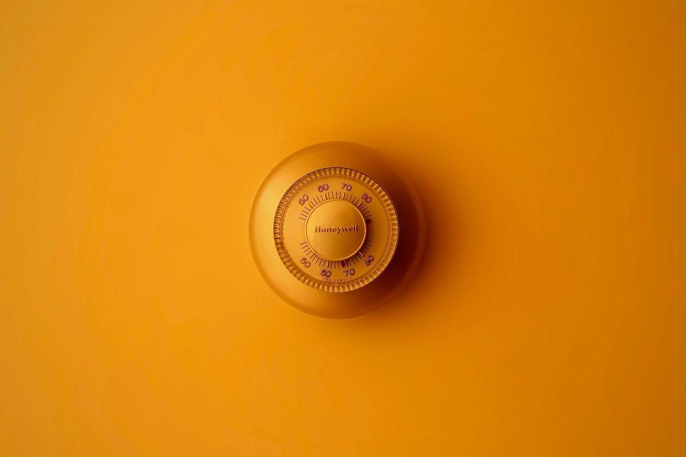 Safe lock against an orange background