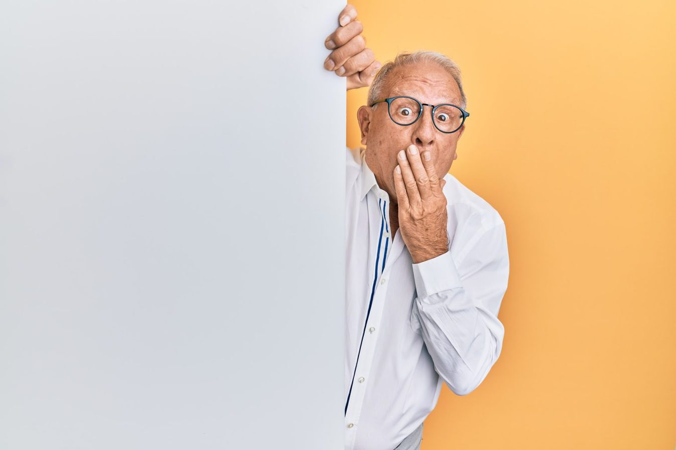 A man going oops against a yellow background