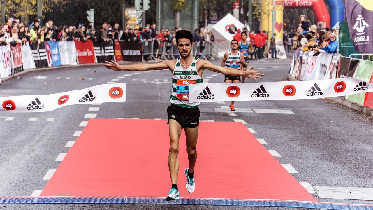 A man running across the finishing line