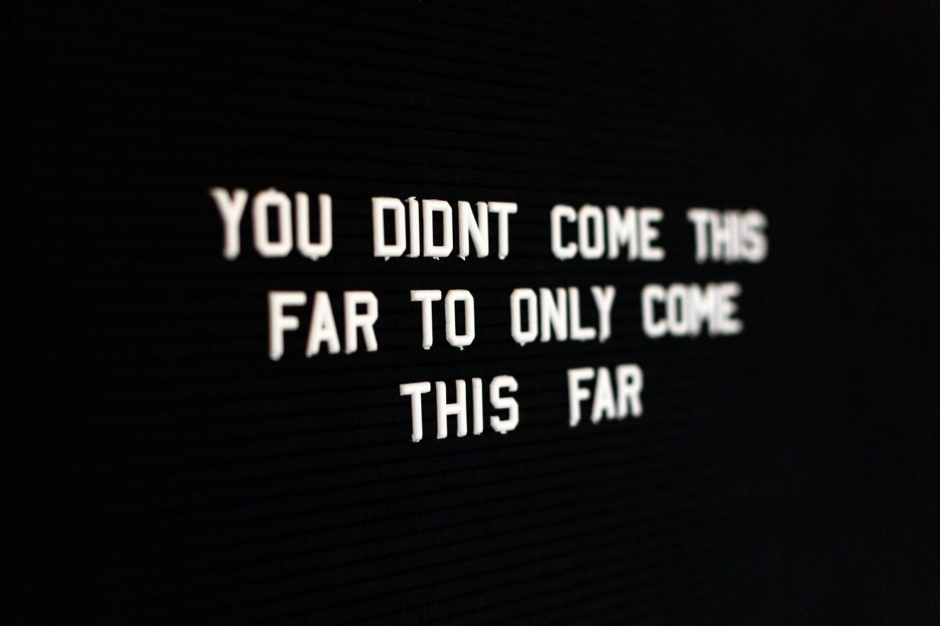 Motivational sign in black