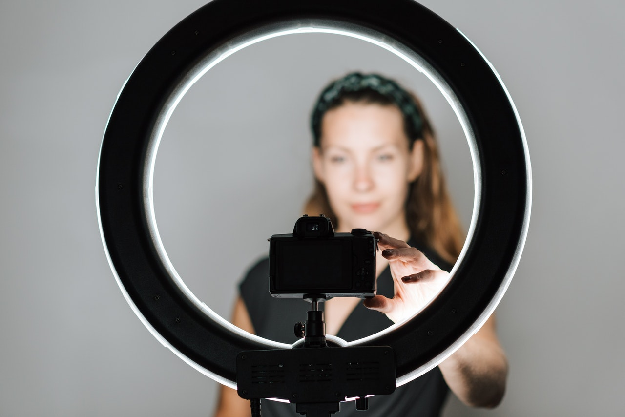 A person testing a round studio lighting out
