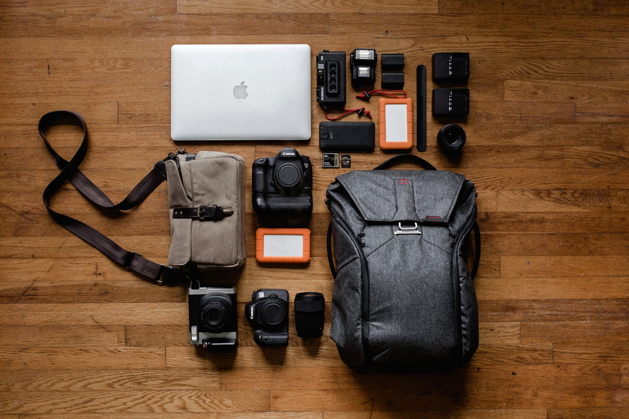 Photography equipment laid out on wooden floor