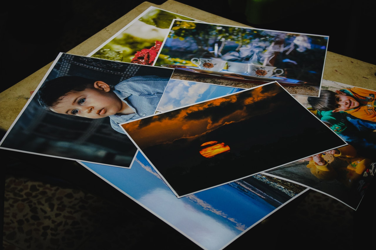 Pile of images against a dark background