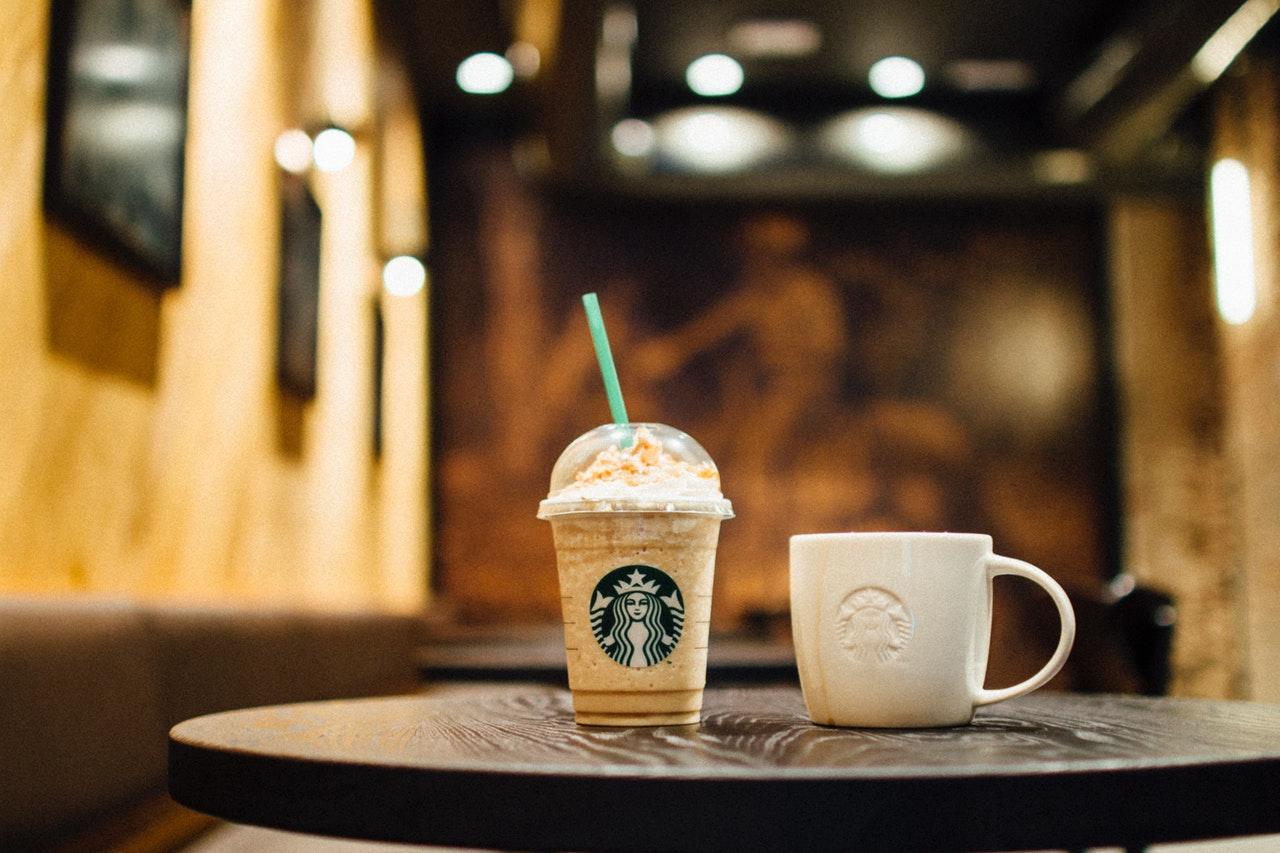 Starbucks mugs on a desk inside a coffee shop
