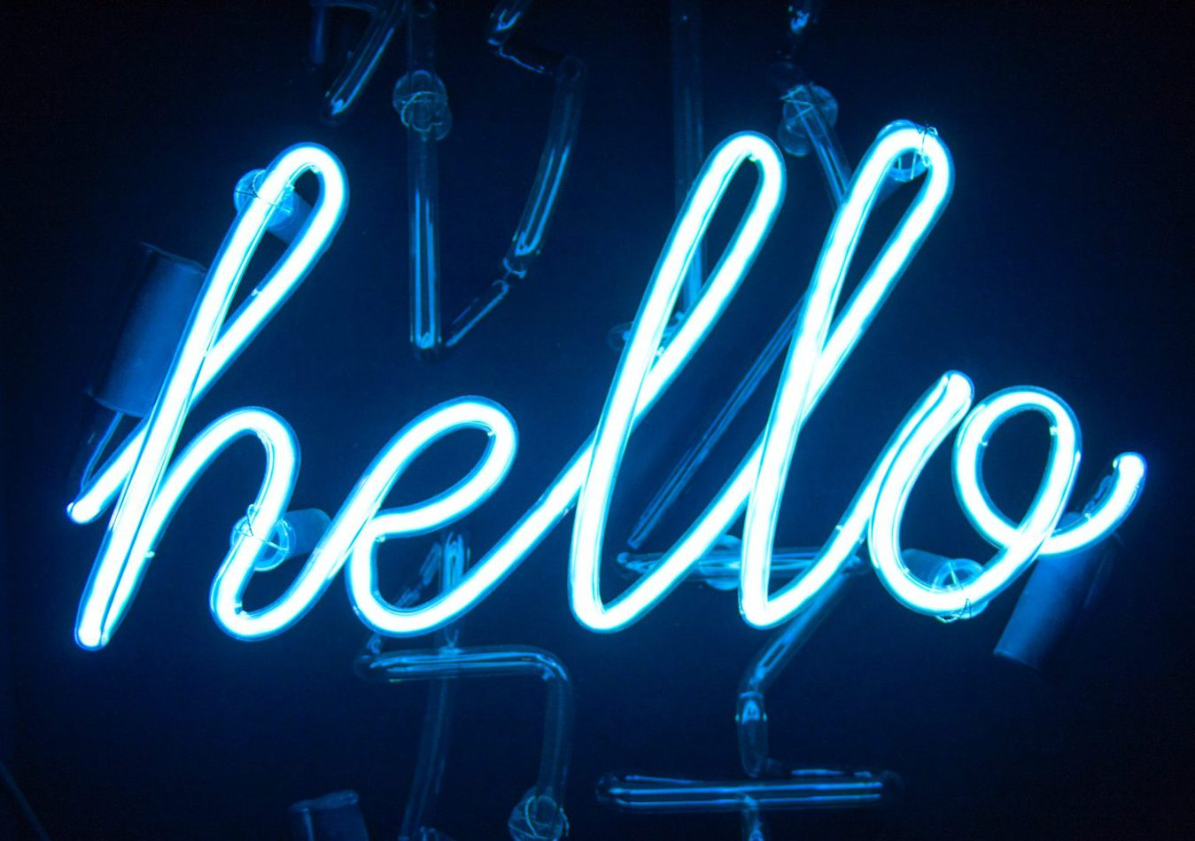 blue neon sign that says 'hello' in cursive writing