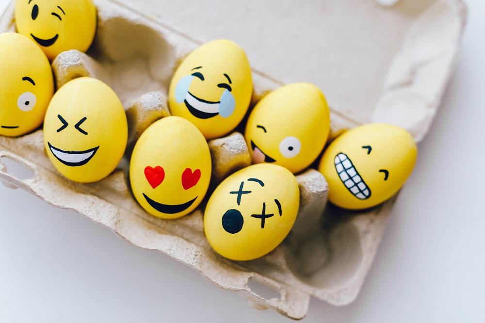eggs painted like yellow emojis