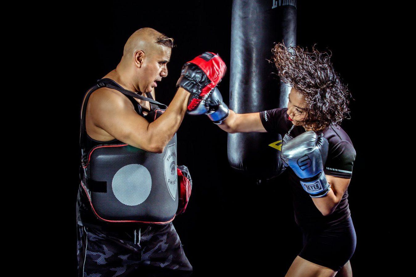 man and woman practising boxing