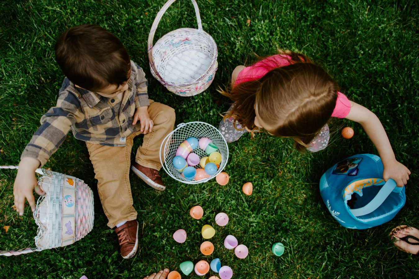 overhead shot of children counting Easter eggs out of baskets