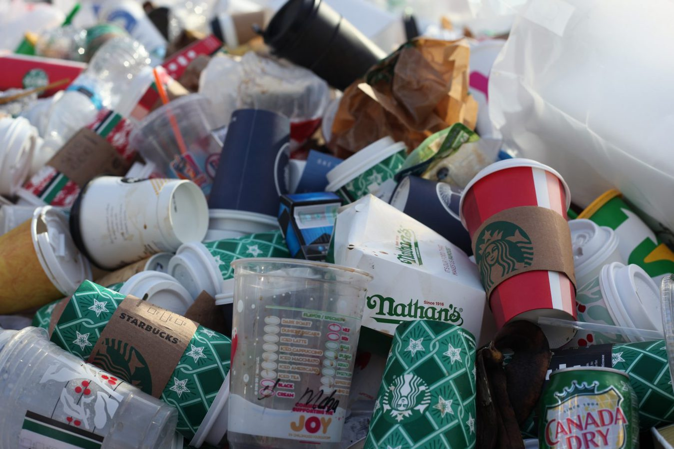 pile of paper cups and other garbage