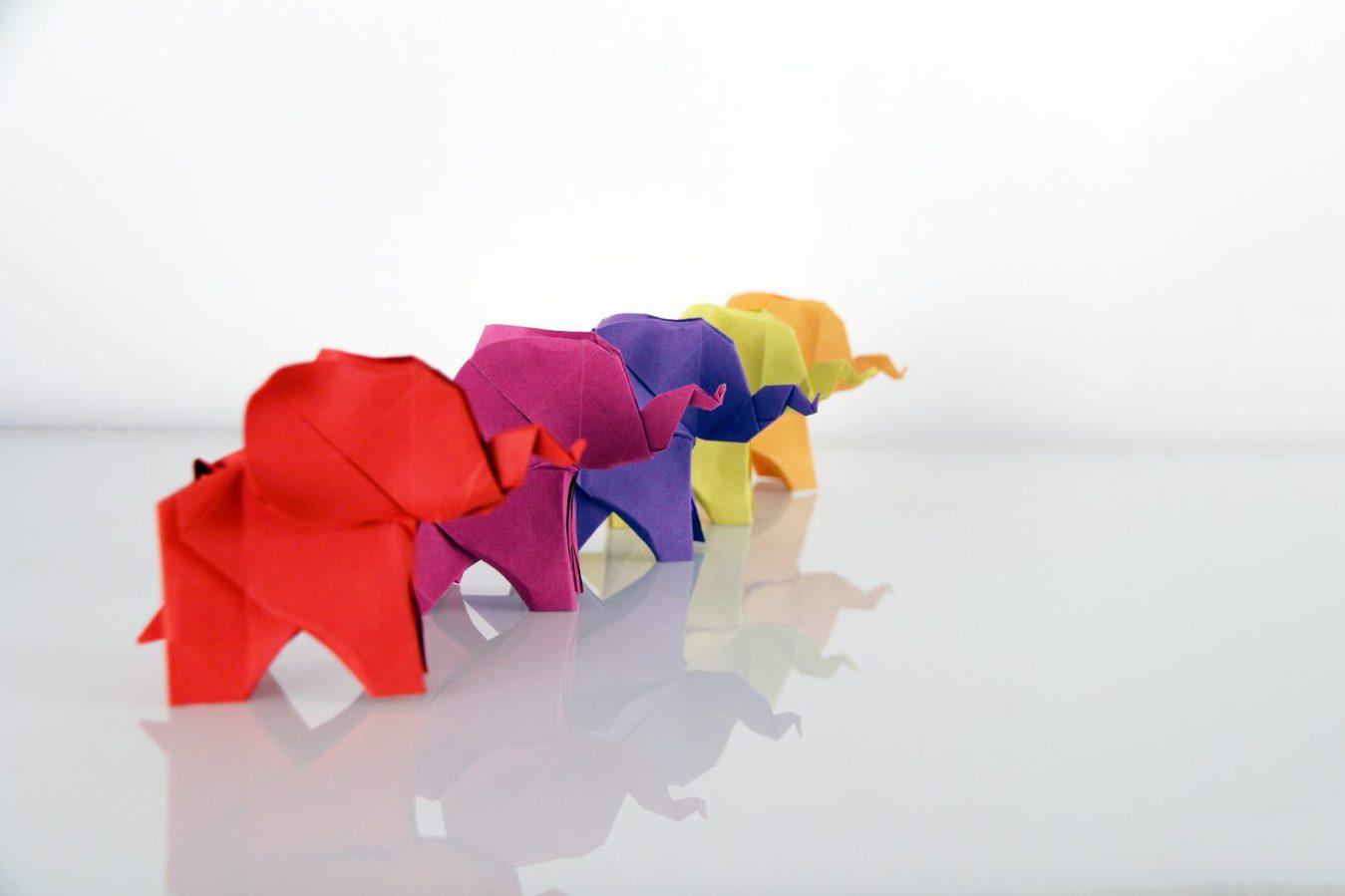 row of multicolored origami elephants