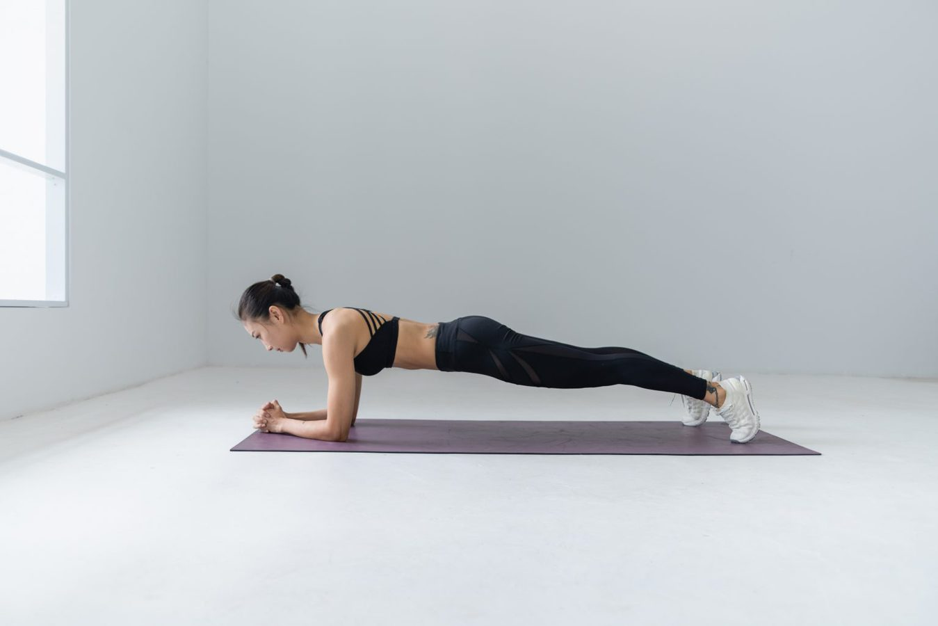 woman planking on exercise mat