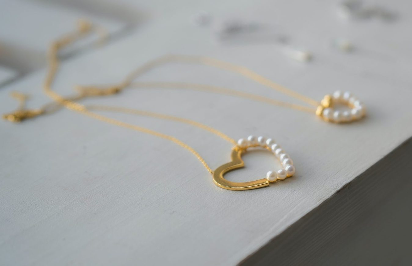 gold and pearl heart shaped necklaces